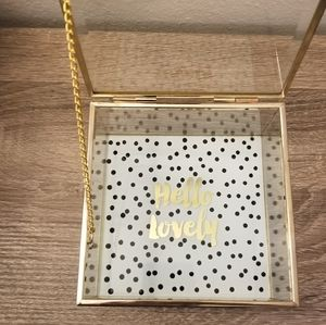 Gold and glass ticket box